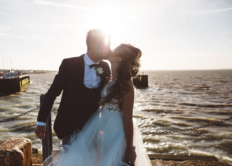 Bride Bridal Hayley Paige Dress Gown Tulle Princess Tuxedo Groom Waistcoat Navy Bow Tie Bouquet Ribbon Cool Stylish Windy Coastal Wedding East Quay Lobster Shack Whitstable http://holliecarlinphotography.com/