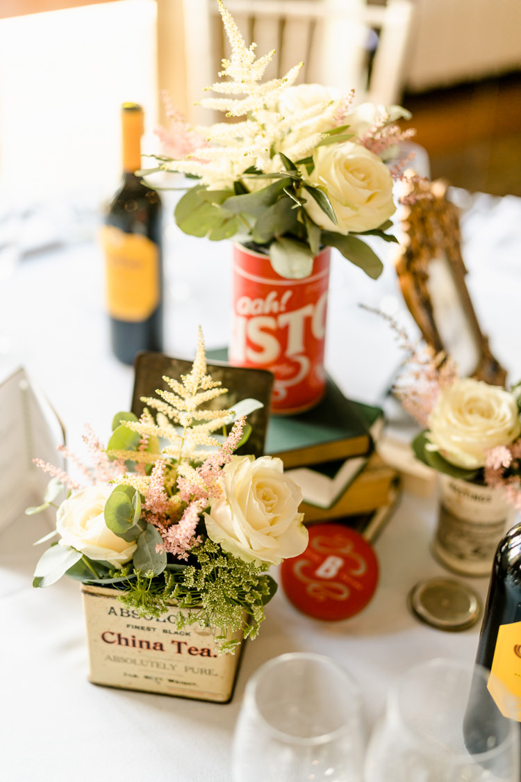 Tea Tin Table Centre Jar Rose Eucalpytus Books Vintage Nostalgic Honest British Loseley Park Wedding Surrey https://www.johnbarwoodphotography.co.uk/