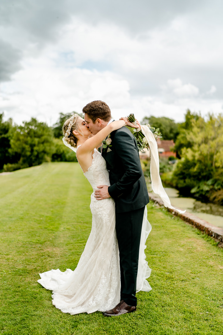 Lace Keyhole Neck Fitted Pronovias Dress Gown Bride Bridal Bottle Green Reiss Suit Groom Bouquet Ribbon Nostalgic Honest British Loseley Park Wedding Surrey https://www.johnbarwoodphotography.co.uk/