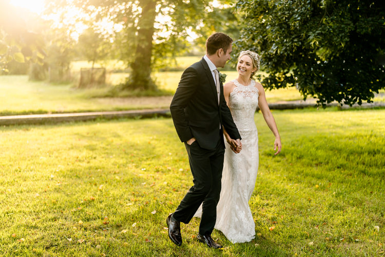 Lace Keyhole Neck Fitted Pronovias Dress Gown Bride Bridal Faux Flower Crown Veil Reiss Groom Bottle Green Suit Nostalgic Honest British Loseley Park Wedding Surrey https://www.johnbarwoodphotography.co.uk/