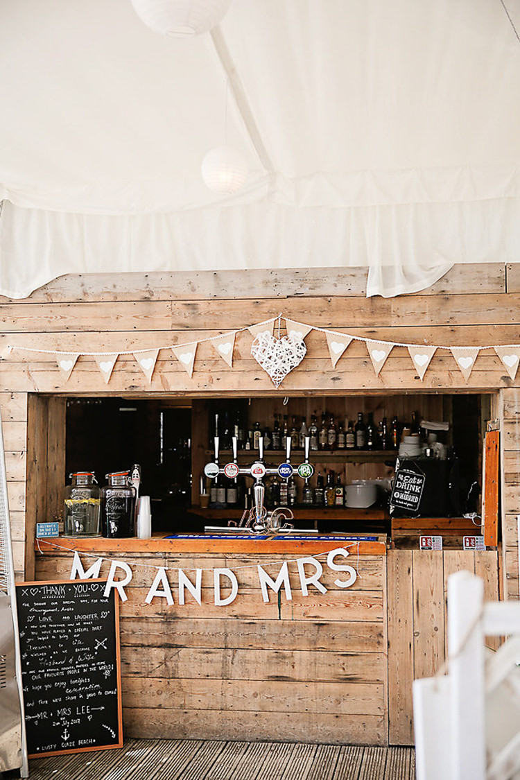 Wooden Shed Bar Bunting Mr & Mrs Chalkboard Menu Pretty Sparkly Lusty Glaze Beach Cornwall Wedding http://victoriamitchellphotography.com/