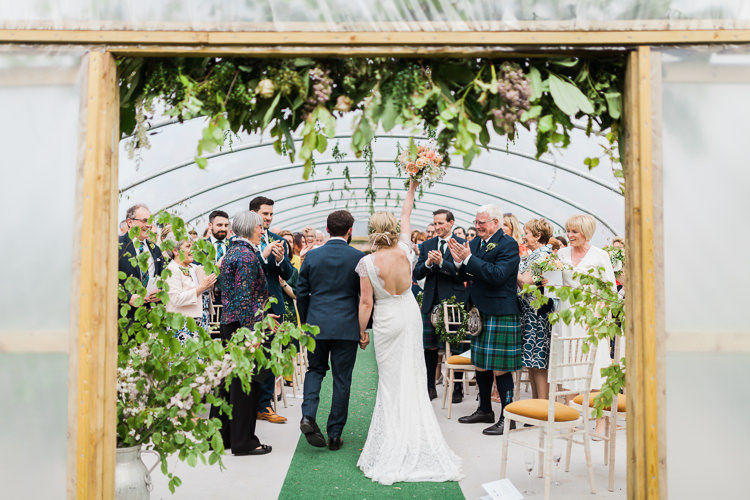 Greenery Foliage Foral Flowers Backless Dress Bride Bridal Gown Ceremony Spring Floral Polytunnel Sunny Wedding Colstoun House Scotland http://solenphotography.co.uk/