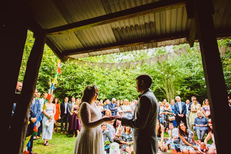Bride Bridal Lace long Sleeved Dress Gown V Neck Wild Flower Crown Yellow Dip Dye Underskirt Bunting Prayer Flags Woodland Organic Farm Shop Wedding Gloucestershire https://www.edgodden.co.uk/