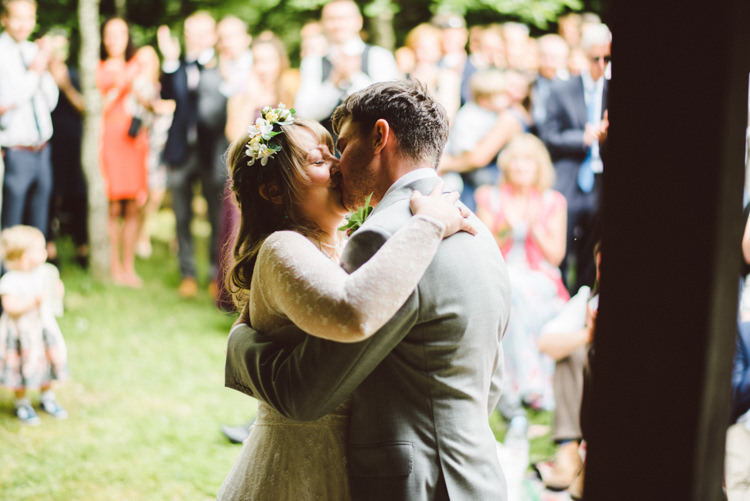 Bride Bridal Lace long Sleeved Dress Gown V Neck Wild Flower Crown Yellow Dip Dye Underskirt Grey Groom Suit Kiss Woodland Organic Farm Shop Wedding Gloucestershire https://www.edgodden.co.uk/