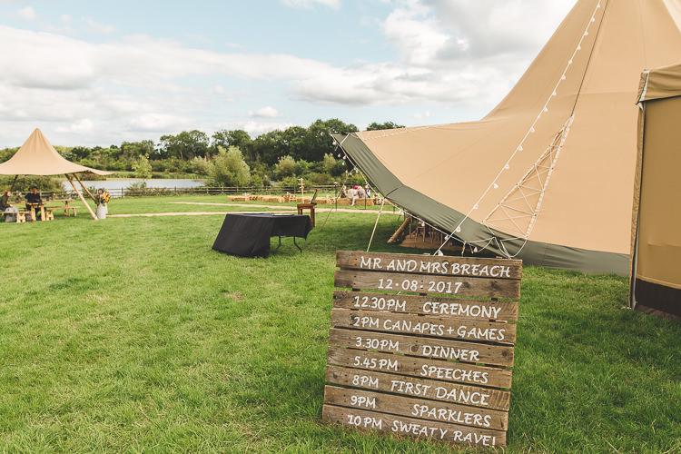 Welcome Sign Pallet Timeline Timings Colourful Outdoor Tipi Farm Wedding https://kirstymackenziephotography.co.uk/