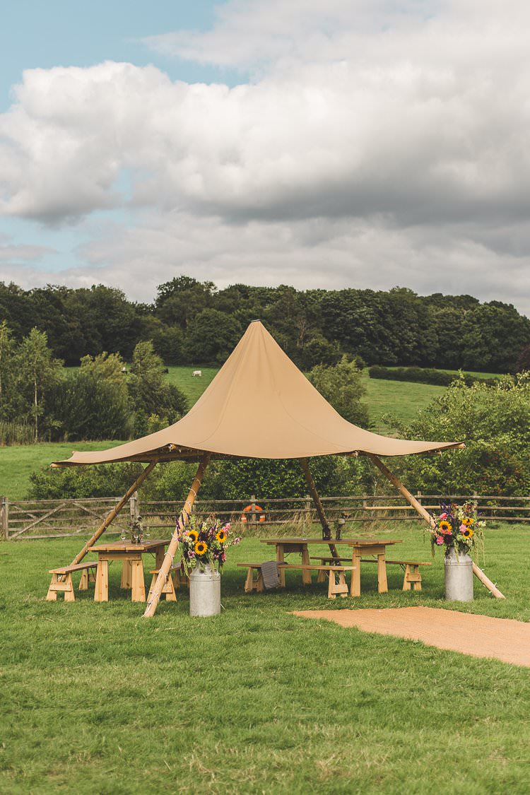 Mini Tipi Seating Area Milk Churns Sunflowers Colourful Outdoor Tipi Farm Wedding https://kirstymackenziephotography.co.uk/