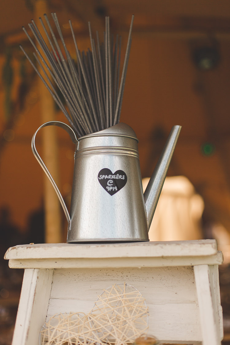 Sparklers Watering Can Steel Metal Colourful Outdoor Tipi Farm Wedding https://kirstymackenziephotography.co.uk/