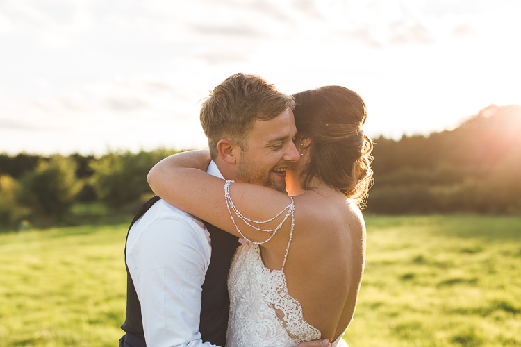 Bride Bridal Sottero & Midgeley Dress Gown Lace Shoulder Detail Richard James Suit Three Piece Waistcoat Blue Groom Colourful Outdoor Tipi Farm Wedding https://kirstymackenziephotography.co.uk/