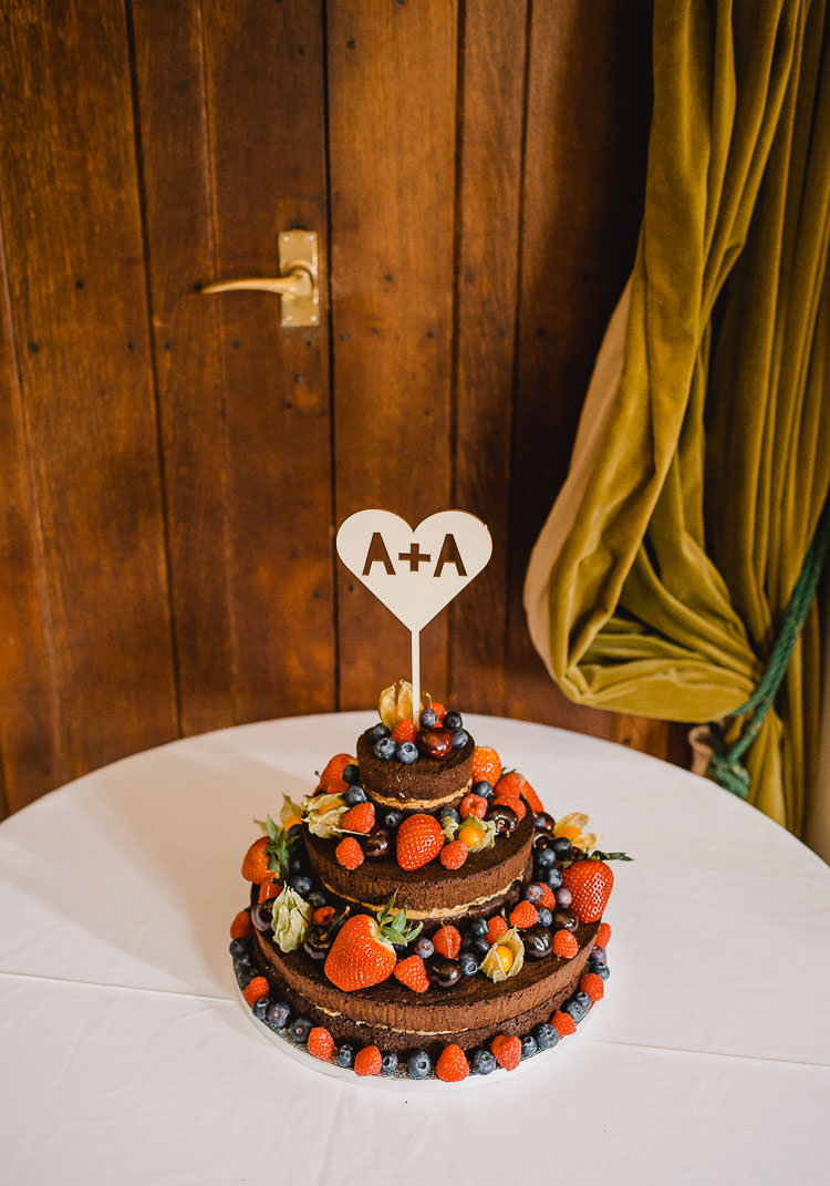 Naked Chocolate Layer Cake Berries Raucous Artistic Wintry Wedding Voewood Norfolk https://www.luisholden.com/