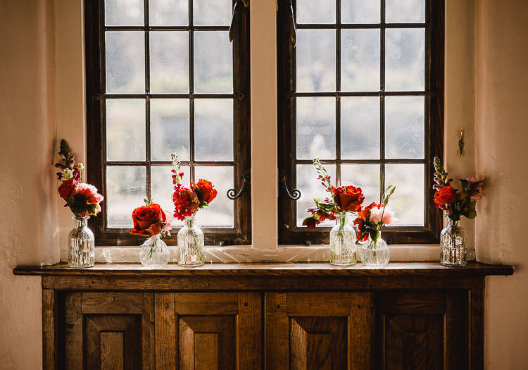 Glass Bottles Flowers Red Pink Roses Raucous Artistic Wintry Wedding Voewood Norfolk https://www.luisholden.com/