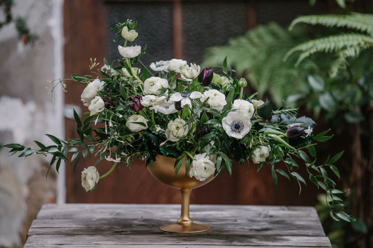 Gold Compote Centrepieces Flowers White Green Plum Tulips Anemone Ranunculus Luxe Industrial Velvet Wedding Ideas https://jessypapasavvaphotography.com/