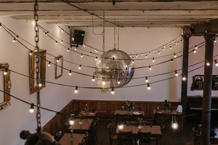 Festoon Lights Disco Ball Luxe Industrial Velvet Wedding Ideas https://jessypapasavvaphotography.com/