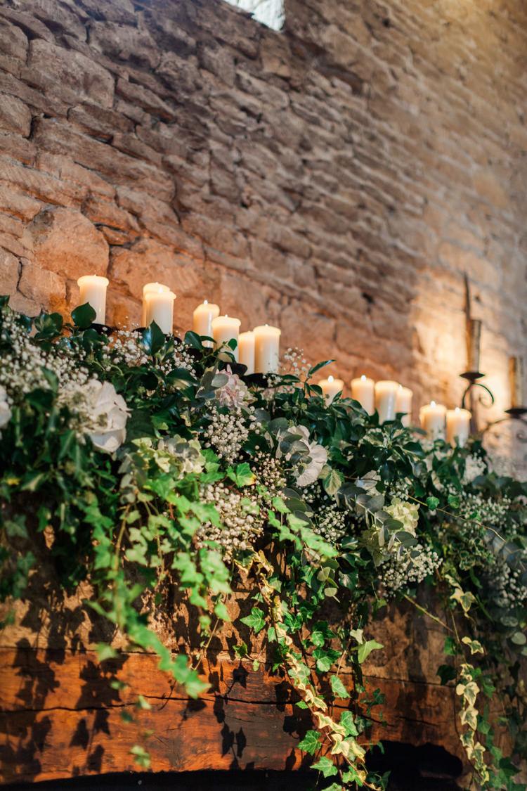 Flowers Arrangement Ceremony Fireplace Mantle Candles Greenery White Hydrangea Gypsophila Hazy Summer Lavender Grey Wedding Cripps Barn Cotswolds http://jobradbury.co.uk/
