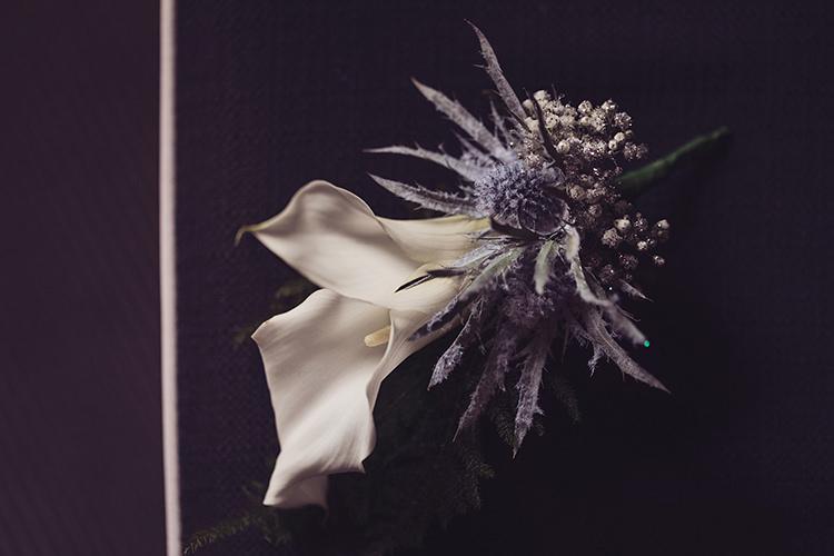 Buttonhole Lily Thistle Gypsophila Glitter Magical Wonderland Askham Hall Wedding Winter Tiree Dawson Photography