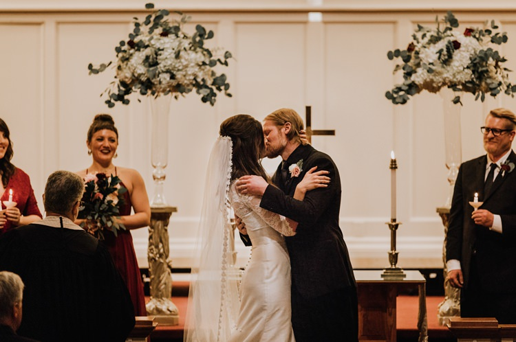 Warehouse Rustic Chic Refined Church Aisle Ceremony Groom Bride Kiss | Boho Industrial Winter Wedding Lunalee Photography