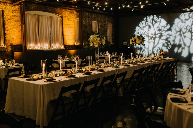 Warehouse Rustic Chic Refined Atlanta King Plow Wedding Table Black Chairs White Flowers | Boho Industrial Winter Wedding Lunalee Photography