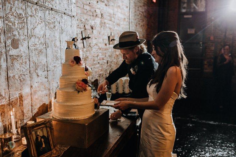 Warehouse Rustic Chic Refined Atlanta King Plow Bride Groom Wedding Cake Cut | Boho Industrial Winter Wedding Lunalee Photography