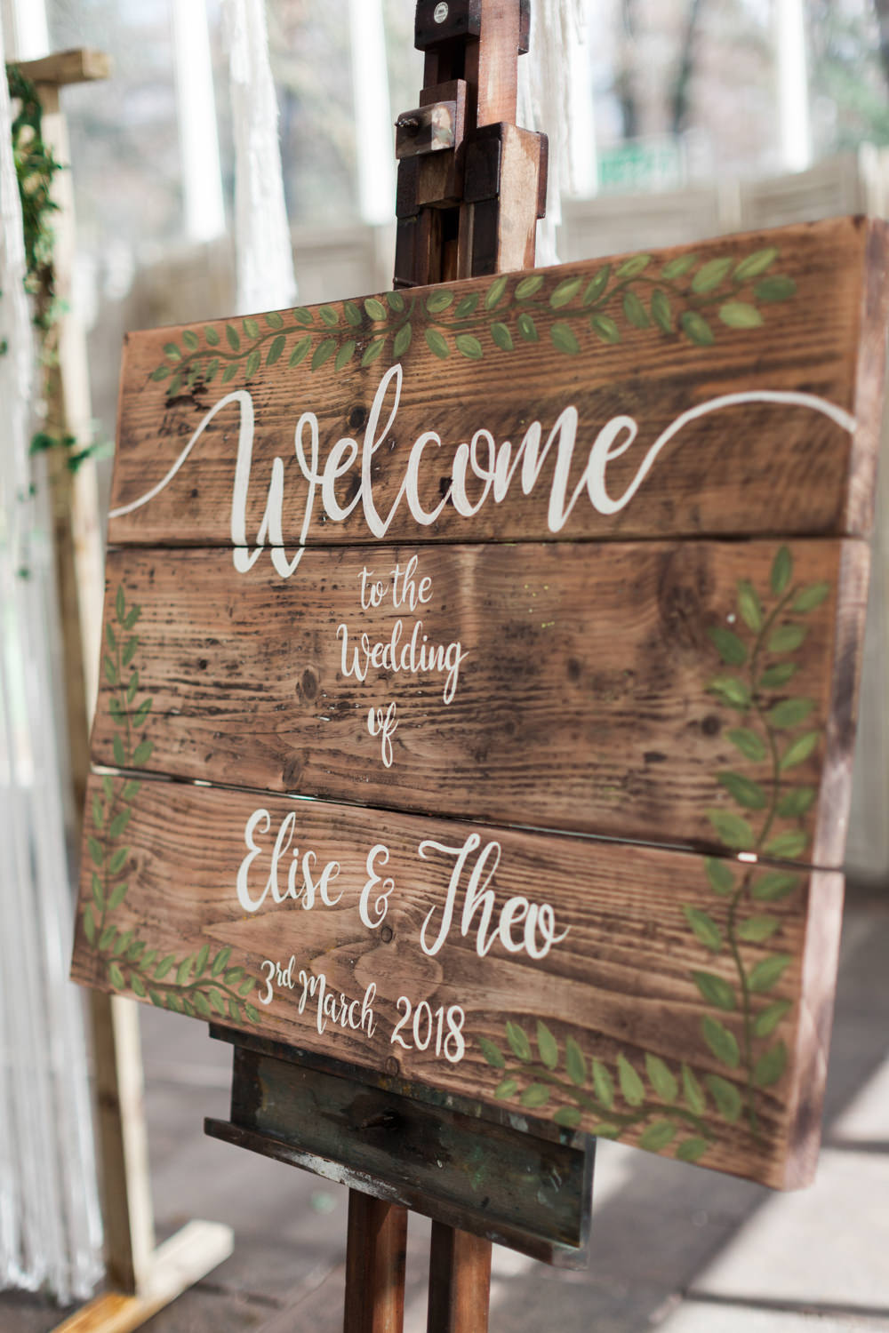 Wooden Rustic Welcome Sign Calligraphy Painted Botanical Macrame Glass House Wedding Ideas Jo Bradbury Photography