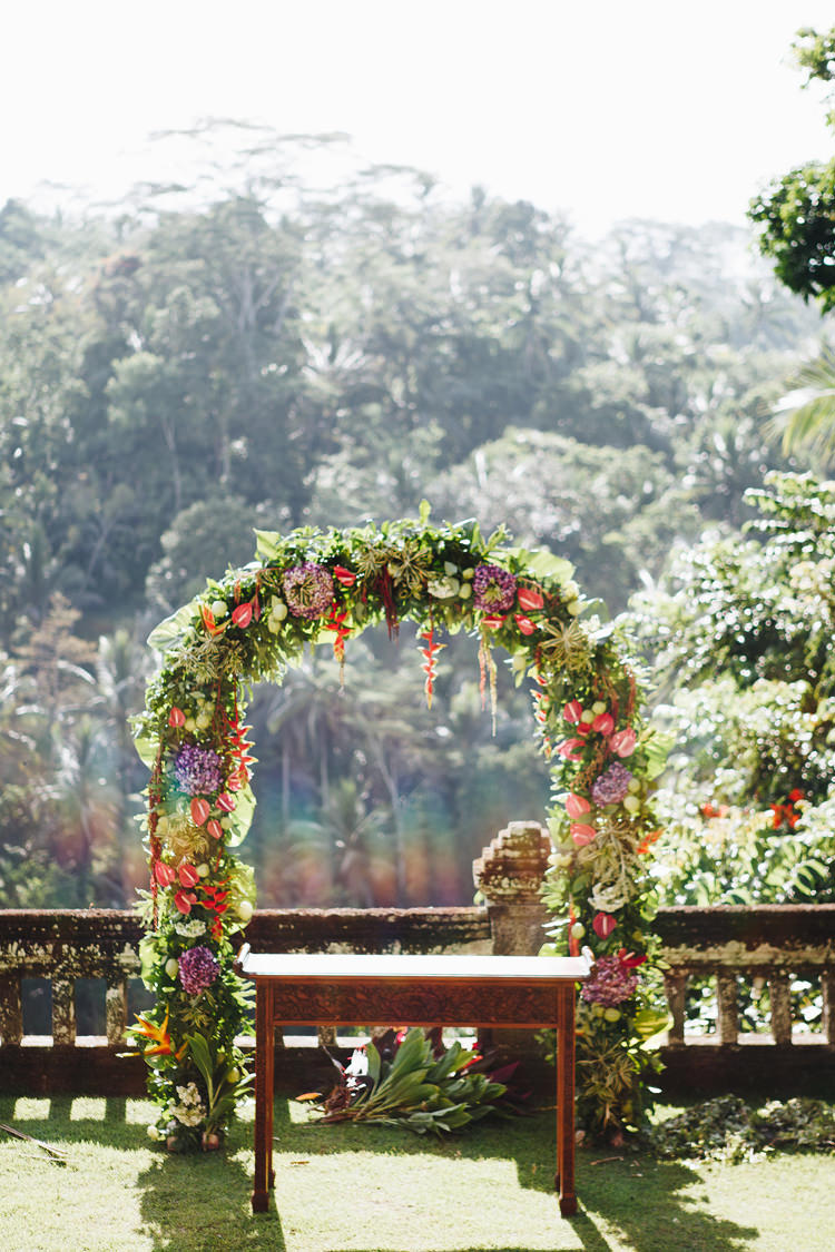 Outdoor Destination Luxury Adventure Ubud Ceremony Tropical Foliage Floral Arch | Whimsical Exotic Tropical Jungle Wedding Bali http://www.cecilephotographybali.com/
