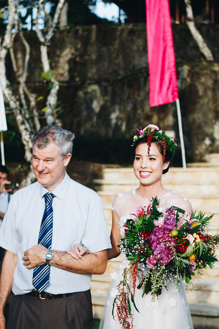 Outdoor Destination Luxury Adventure Ubud Ceremony Bride Colorful Flower Crown Tropical Bouquet | Whimsical Exotic Tropical Jungle Wedding Bali http://www.cecilephotographybali.com/