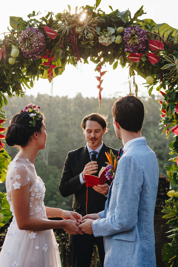 Outdoor Destination Luxury Adventure Ubud Ceremony Bride Colorful Flower Crown Tropical Floral Arch | Whimsical Exotic Tropical Jungle Wedding Bali http://www.cecilephotographybali.com/