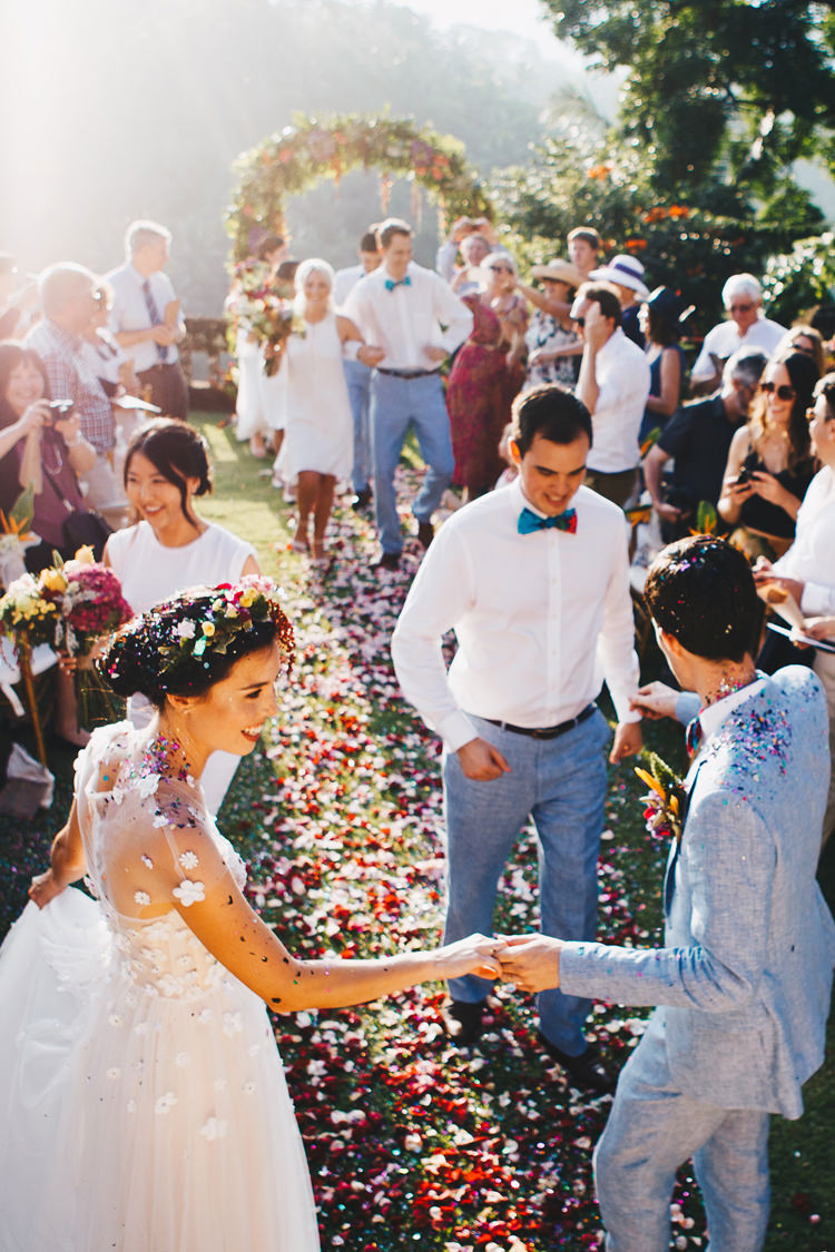 Outdoor Destination Luxury Adventure Ubud Ceremony Bride Colorful Flower Crown Tropical Floral Arch Confetti | Whimsical Exotic Tropical Jungle Wedding Bali http://www.cecilephotographybali.com/