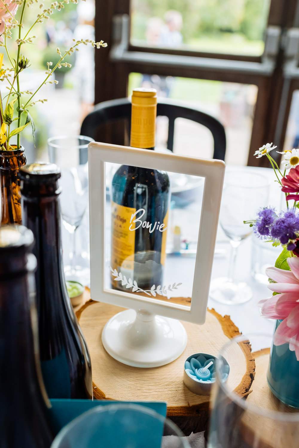 Table Name Frame Glass Calligraphy Wood Slice Laid Back Harry Potter Wedding Daffodil Waves Photography