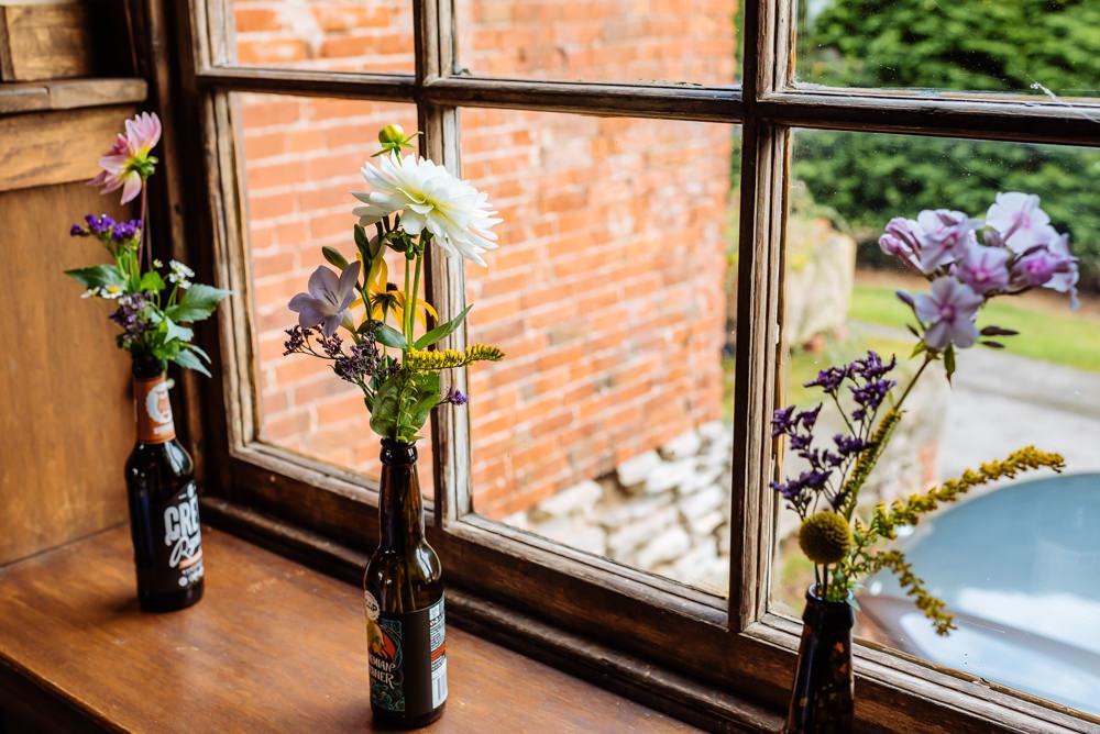 Beer Bottle Vases Florals Flowers Laid Back Harry Potter Wedding Daffodil Waves Photography