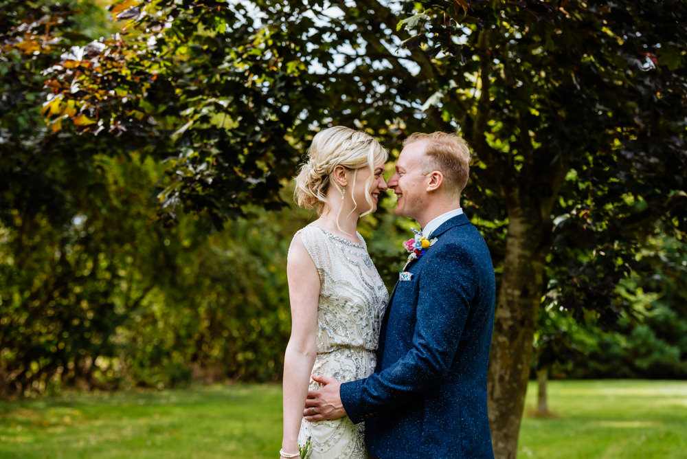 Bride Bridal Jenny Packham Beaded Dress Gown Shift Embellished Blue Tweed Next Bow Tie Liberty Print Groom Three Piece Laid Back Harry Potter Wedding Daffodil Waves Photography