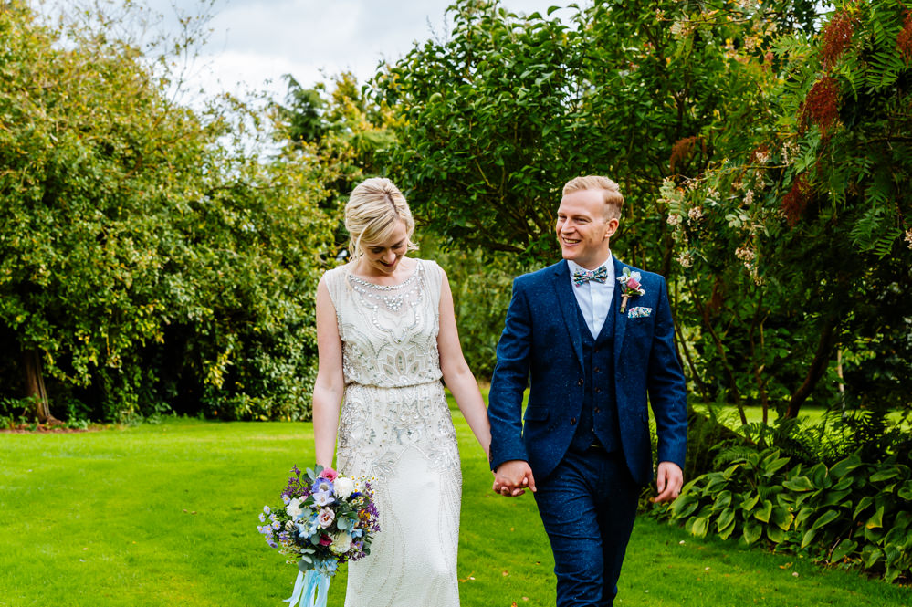 Bride Bridal Jenny Packham Beaded Dress Gown Shift Embellished Blue Tweed Next Bow Tie Liberty Print Groom Three Piece Bouquet Wild Flowers Meadow Ribbons Laid Back Harry Potter Wedding Daffodil Waves Photography