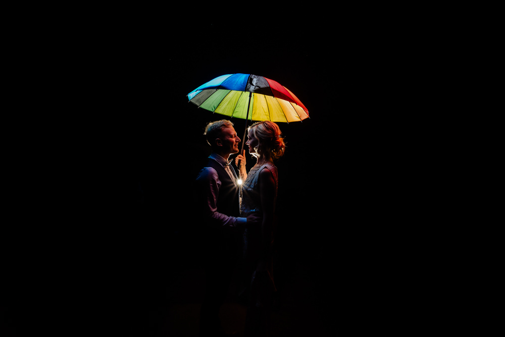 Couples Portrait Rainbow Umbrella Laid Back Harry Potter Wedding Daffodil Waves Photography