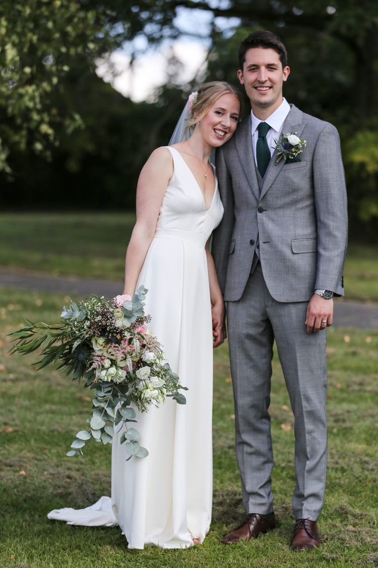 Bride Bridal V Neck Charlie Brear Dress Gown Ted Baker Groom Waistcoat Three Piece Grey Green Tie Loose Wild Bouquet Manor Farm Wedding Hampshire Luke Doyle Photography