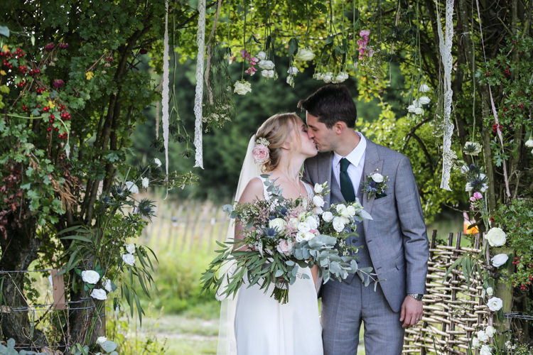 Bride Bridal V Neck Charlie Brear Dress Gown Ted Baker Groom Waistcoat Three Piece Grey Green Tie Loose Wild Bouquet Lace Ribbons Floral Installation Hanging Manor Farm Wedding Hampshire Luke Doyle Photography