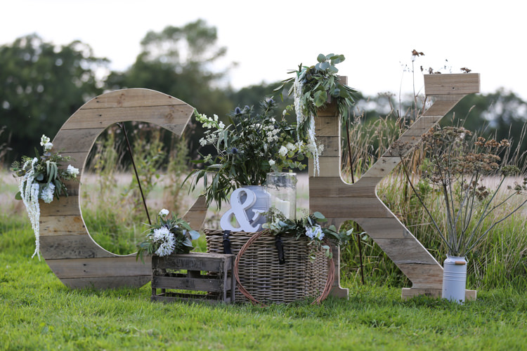 Giant Wooden Letters Rustic Outdoor Floral Wooden Crates Wicker Basket Manor Farm Wedding Hampshire Luke Doyle Photography