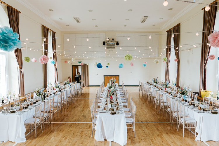 Festoon Lights Pom Poms Decor Long Tables Pretty Pastel Floral Village Hall Wedding Struve Photography
