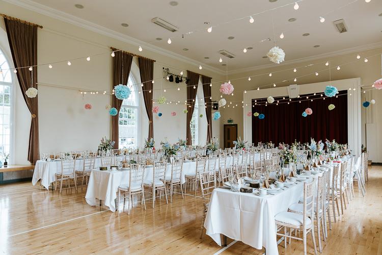Festoon Lights Pompoms Decor Reception Pretty Pastel Floral Village Hall Wedding Struve Photography
