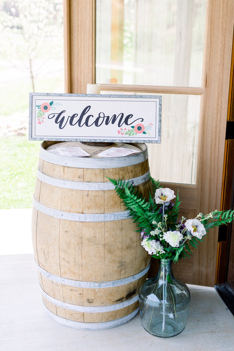 Barrel Wooden Welcome Sign Flowers Romantic Spring Pastel Farm Wedding Ashley Spangler Photography