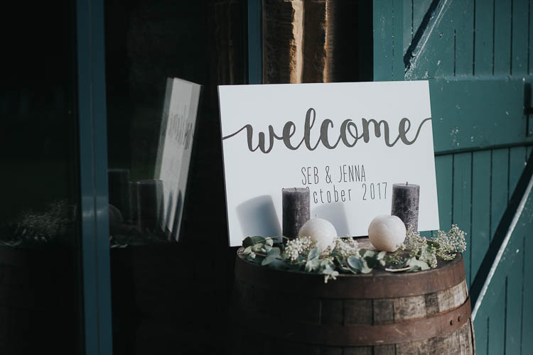 Welcome Sign Brush Lettering Barrel Candle Greenery Foliage The Byre at Inchyra Wedding Jen Owens Images