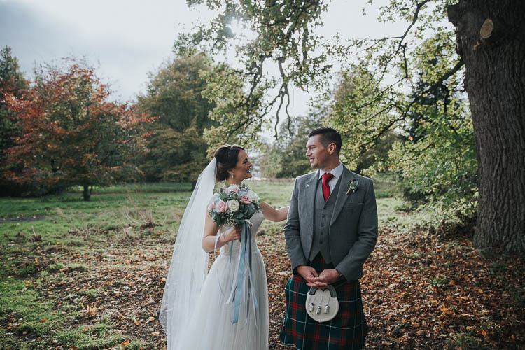 Bride Bridal Dress Gown Lace Sweetheart Neckline Short Sleeve Full Skirt Kilt Groom Tartan Waistcoat Red Green Bouquet Ribbons First Look The Byre at Inchyra Wedding Jen Owens Images