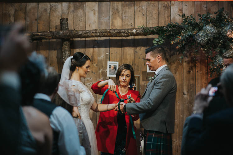 Ceremony Handfasting Bride Bridal Dress Gown Lace Sweetheart Neckline Short Sleeve Full Skirt Kilt Groom Tartan Waistcoat Red Green The Byre at Inchyra Wedding Jen Owens Images