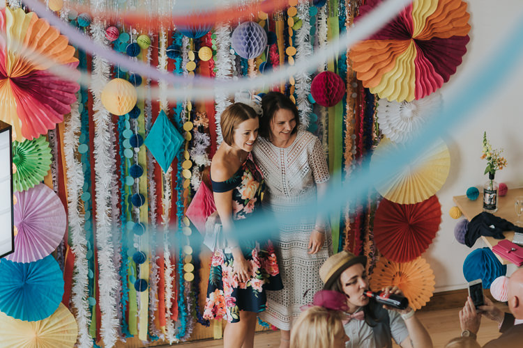 Streamers Pom Poms Paper Pin Wheels Backdrop Photo Booth The Workstation Cinema Colourful Wedding Bloom Weddings