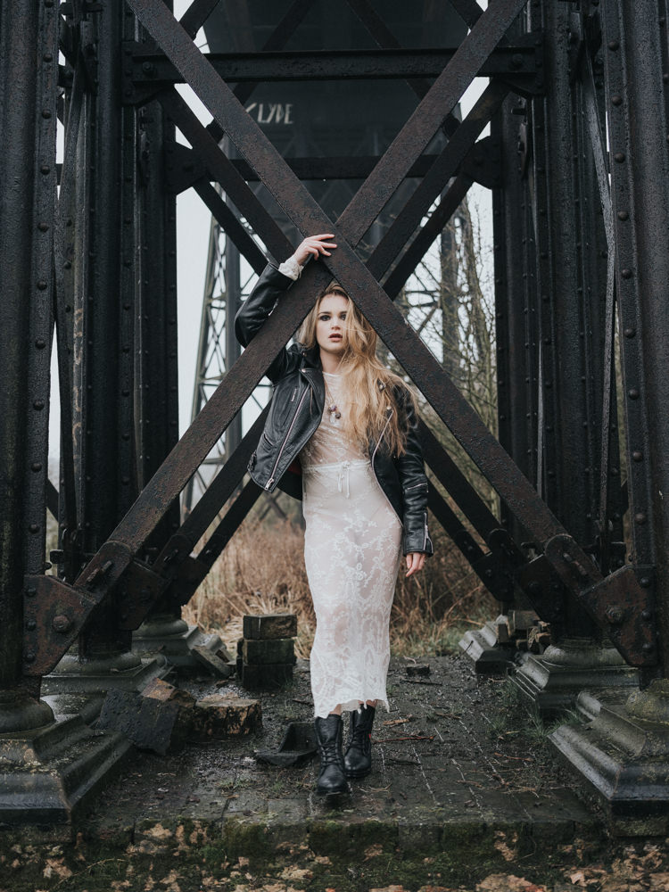 Bride Bridal Lace Sheer Dress Gown Leather Jacket Boots Alternative Edgy Naked Tipi Backdrop Wedding Ideas http://www.ivoryfayre.com/
