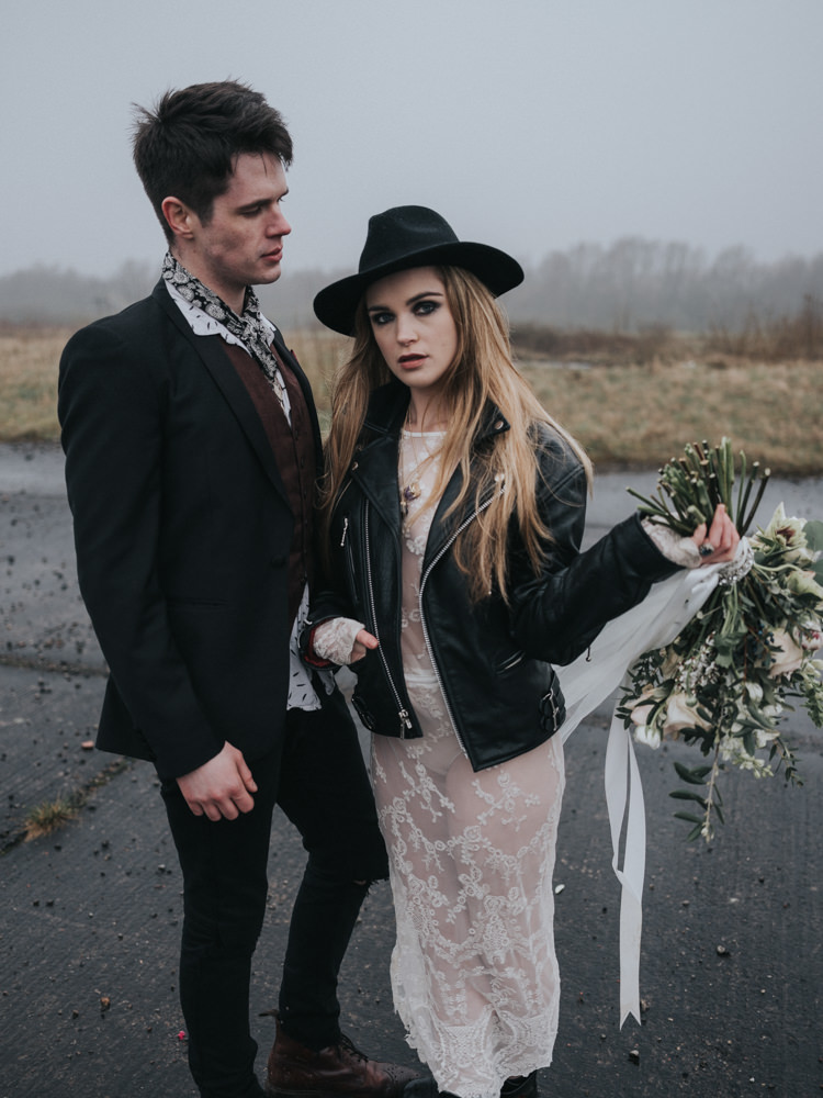 Bride Bridal Lace Sheer Dress Gown Leather Jacket Boots Hat Alternative Edgy Naked Tipi Backdrop Wedding Ideas http://www.ivoryfayre.com/