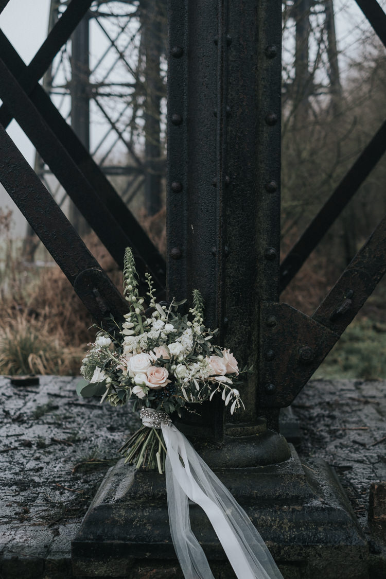 Bouquet Flowers Bride Bridal Blush Pink Greenery Foxgloves Larkspur Ammi Rose Ranunculus Hellebores Olive Eucalyptus Tulle Ribbon Alternative Edgy Naked Tipi Backdrop Wedding Ideas http://www.ivoryfayre.com/