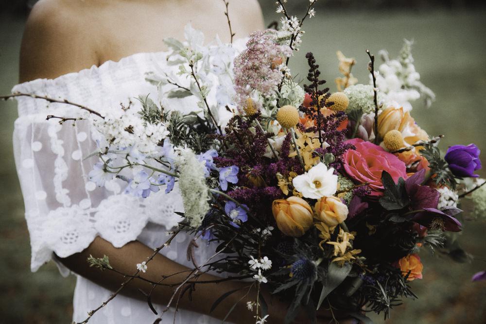 Bouquet Flowers Bride Bridal Rose Craspedia Thistle Hellebore Astilbe Tulip Colourful Boho Festival Wedding Ideas Ella Violet Photography