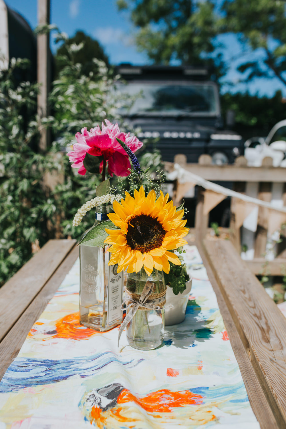 Bottle Jar Flowers Sunflower Table Decor Colourful Bright Summer Pub Wedding Charlotte Razzell Photography
