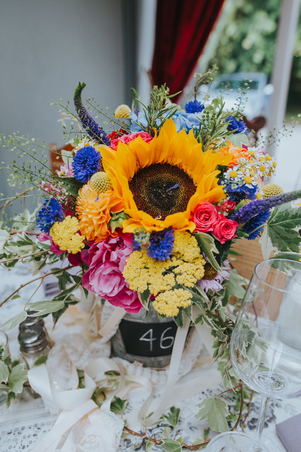 Flowers Peony Hydrangea Sunflower Daisy Cornflowers Craspedia Bucket Table Colourful Bright Summer Pub Wedding Charlotte Razzell Photography