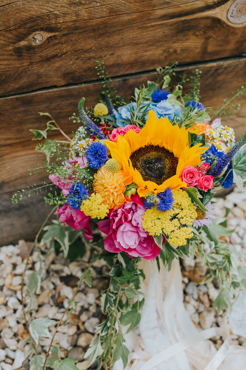 Bouquet Flowers Bride Bridal Peony Hydrangea Sunflower Daisy Cornflowers Craspedia Ribbons Colourful Bright Summer Pub Wedding Charlotte Razzell Photography