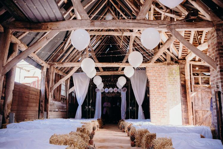 Ceremony Decor Hay Bales Balloons Pinwheels Fairy Lights Creative Hertfordshire Barn Boho DIY Wedding Beard and Mane Photography