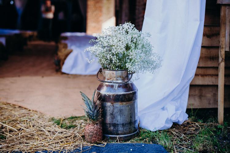 Milk Churns Flowers Gypsophila Pineapple Creative Hertfordshire Barn Boho DIY Wedding Beard and Mane Photography